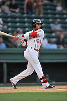 Second baseman Yoan Moncada (24) of the Greenville Drive bats in a game against the Savannah Sand Gnats on Thursday, September 3, 2015, at Fluor Field at the West End in Greenville, South Carolina. (Tom Priddy/Four Seam Images)