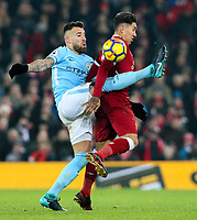 Liverpool's Roberto Firmino is tackled by Manchester City's Nicolas Otamendi<br /> <br /> Photographer Alex Dodd/CameraSport<br /> <br /> The Premier League - Liverpool v Manchester City - Sunday 14th January 2018 - Anfield - Liverpool<br /> <br /> World Copyright &copy; 2018 CameraSport. All rights reserved. 43 Linden Ave. Countesthorpe. Leicester. England. LE8 5PG - Tel: +44 (0) 116 277 4147 - admin@camerasport.com - www.camerasport.com
