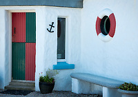 Nautical decorations on house . Dunseverick Harbor, Northern Ireland.