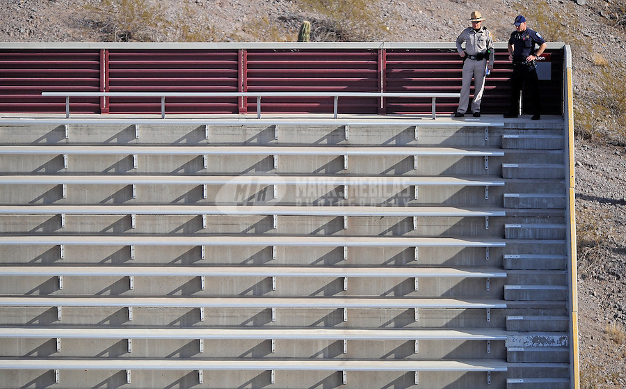 Nov. 28, 2009; Tempe, AZ, USA; Police officers keep an eye over the crowd during the game between the Arizona State Sun Devils against the Arizona Wildcats at Sun Devil Stadium. Arizona defeated Arizona State 20-17. Mandatory Credit: Mark J. Rebilas-
