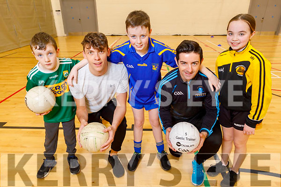Shane Roche (Tralee), David Clifford, Conor McCarthy (Ballymac), Aidan O'Mahony and Muireann Hussey (Kilflynn) enjoying the indoor GAA games at the Kerry Sports Academy Open Day at the I T Tralee on Saturday.