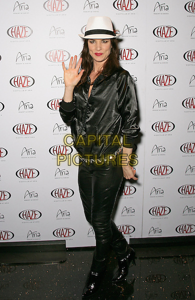 JULIETTE LEWIS.Special Performance at Haze Nightclub inside Aria Resort Hotel and Casino at CityCenter, Las Vegas, Nevada, USA..April 1st, 2010.full length trousers jacket black white trilby hat hand waving palm.CAP/ADM/MJT.© MJT/AdMedia/Capital Pictures.