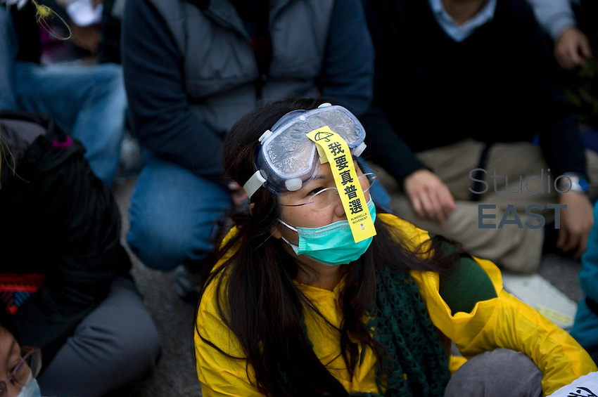 HONG KONG - DECEMBER 11: A protester sits down waiting to be arrested by police during the clearance of Occupy Central Pro-democracy camp in Admirality, on December 11, 2014 in Hong Kong, Hong Kong. (Photo by Lucas Schifres/Getty Images)