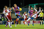 Kenny Miller's overhead kick is blocked by David Raven