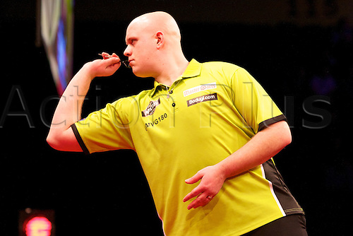 14.03.2013 Manchester, England. Michael van Gerwen in action during round six of the Premier League Darts from the MEN Arena.