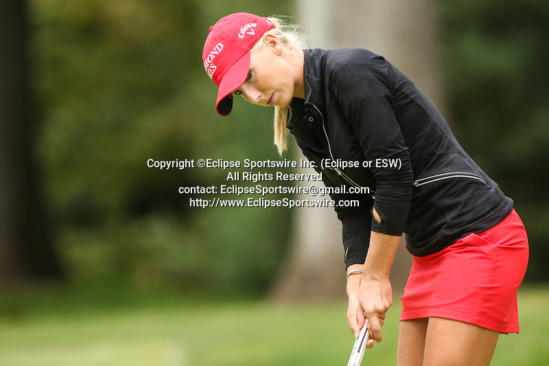 Brooke Pancake watches her putt on the 11th green at the LPGA Championship 2014 Sponsored By Wegmans at Monroe Golf Club in Pittsford, New York on August 16, 2014