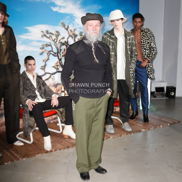 Fashion designer Michael Rubin poses with models during his Krammer & Stoudt Fall Winter 2019 collection, on February 4, 2019; at 55 Water Street for New York Men's Day Fall Winter 2019, during New York Fashion Week: Men's Fall Winter 2019.