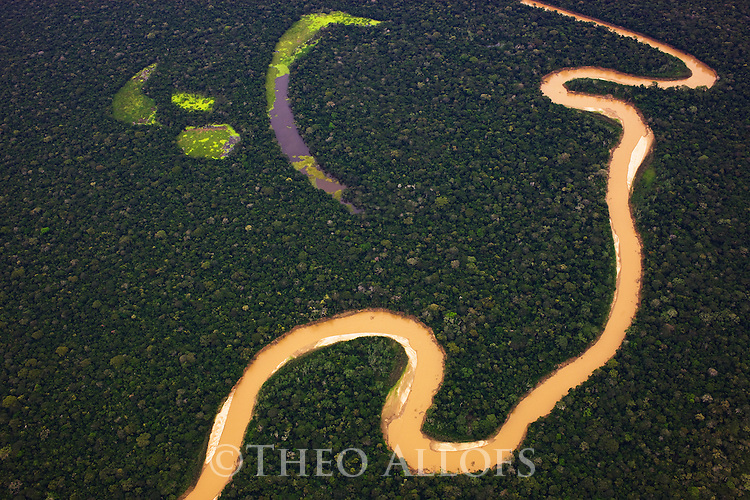 Bolivia, Beni Department, aerial view of winding river and oxbow lake in tropical rain forest, Amazon basin