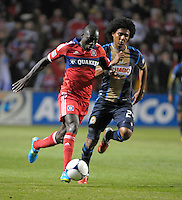 Chicago Fire forward Dominic Oduro (8) dribbles down the field while being pursued by Philadelphia Union defender Porfirio Lopez (24).  The Chicago Fire defeated the Philadelphia Union 1-0 at Toyota Park in Bridgeview, IL on March 24, 2012.