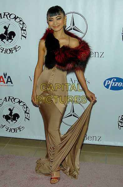 BAI LING.16th Annual Carousel Of Hope Gala Presented By Mercedes-Benz held at Beverly Hills Hotel, Beverly Hills, California, USA, 23rd October 2004 ..full length brown beige gold dress red fur cape stole wrap shawl.**UK SALES ONLY**.Ref:ADM.www.capitalpictures.com.sales@capitalpictures.com.©Capital Pictures.