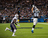 The Carolina Panthers play the New England Patriots at Bank of America Stadium in Charlotte North Carolina on Monday Night Football.  The Panthers defeated the Patriots 24-20.  Carolina Panthers tight end Greg Olsen (88), New England Patriots defensive back Duron Harmon (30)