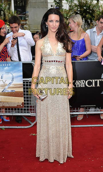 KRISTIN DAVIS in Norman Norell.'Sex And The City 2' European Premiere at the Odeon, Leicester Square, London, England..May 27th, 2010.full length gold sequined sequins beaded beads maxi sleeveless dress gown clutch bag gem encrusted jewel embellished metallic halterneck .CAP/BEL.©Tom Belcher/Capital Pictures.
