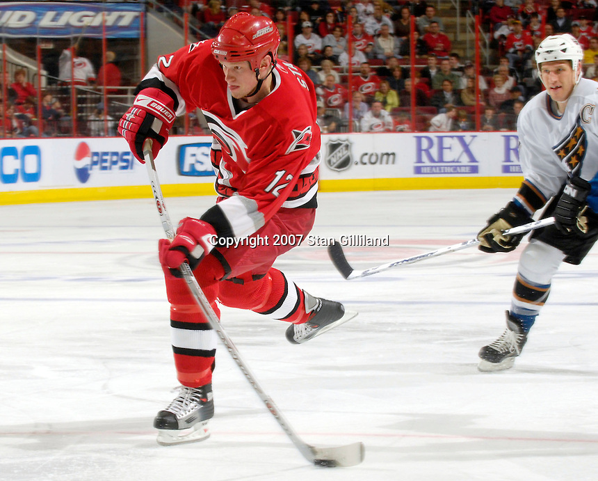 Carolina Hurricanes' Eric Staal gets a shot on goal as the Washington Capitals' Chris Clark watches Thursday, March 22, 2007 at the RBC Center in Raleigh, NC. Carolina won 4-3.