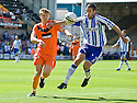 DUNDEE UTD'S STUART ARMSTRONG AND KILMARNOCK'S TIM CLANCY CHALLENGE FOR THE BALL