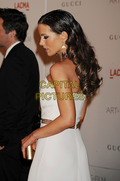Kate Beckinsale.The Inaugural Art and Film Gala held at LACMA in Los Angeles, California, USA..November 5th, 2011.half length dress white strapless dress gold black belt corsage clutch bag side profile .CAP/ROT/TM.©Tony Michaels/Roth Stock/Capital Pictures