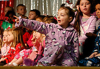 NWA Media/DAVID GOTTSCHALK - 12/16/14 -  Kayleigh Meeks, a kindergarten student at Root Elementary School points to members of the audience prior to performing with three classes of kindergarten students at Root Elementary School in Fayetteville Tuesday December 16, 2014. The theme of the performance was Holiday Dreams and was performed for the school body in the morning followed by a performance in the evening. Additional photographs available at:  www.nwaonline.com/photos