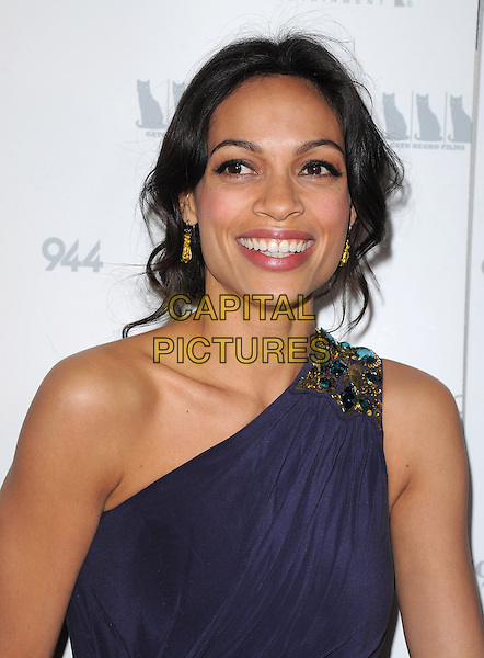 "ROSARIO DAWSON .attends the Shangri-La Entertainment and Gato Negro Films' premiere of ""Girl Walks Into a Bar"" held at The Arclight Theatre in Hollywood, California, USA,  March 7th, 2011..portrait headshot smiling earring blue one shoulder gold beaded shoulder                                       .CAP/RKE/DVS.©DVS/RockinExposures/Capital Pictures."