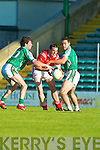 John Brosnan East Kerry finds his path blocked by David O'Callaghan and Paul O'Donoghue St Brendans in the first round of the county championship in Austin Stack park, Tralee on Friday.