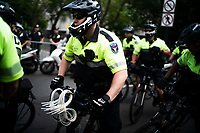 NEW YORK, NEW YORK - June 25: NYPD officers get ready as people get ready to march as others take part in a protest encampment near NYC City hall on June 25, 2020 in New York, NY. Demonstrators are calling for $1 billion in cuts of NYPD, as they protest encampment near City Hall and NYPD headquarters ahead of the city July 1 budget deadline.  (Photo by Eduardo MunozAlvarez/VIEWpress)