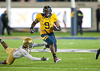 October 6th, 2012: California's C.J. Anderson breaks UCLA defender's tackle for some yardage during a game at Memorial Stadium, Berkeley, Ca    California defeated UCLA 43 - 17