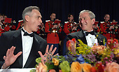 Washington, D.C. - April 29, 2006 -- United States President George W. Bush speaks with Tom Curley of the Associated Press (AP) during the White House Correspondents' Association Dinner in Washington on April 29, 2006.  <br /> Credit: Roger L. Wollenberg - Pool via CNP