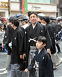 March 27, 2013, Tokyo, Japan - Ichikawa Somegoro, accompanied by his son Matsumoto Kintaro, walks with other Kabuki actors during a parade in the rain through the main street of Tokyo's Ginza shopping district on Wednesday, March 27, 2013, in celebration of the grand opening of new Kabuki theater. After three years of renovation, the majestic theater for Japan's centuries-old performing arts of Kabuki will open its doors to the public with a three-month series of most sought-after plays. (Photo by Kaku Kurita/AFLO)