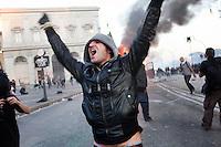Roma: un manifestante esulta per il blindato dei Carabinieri dato alle fiamme durante la manifestazione organizzata dagli indignati. &quot;Occupy Wall Street&quot; &egrave; stata organizzata in 951 citt&agrave; di 82 Paesi per protestare contro la crisi economica mondiale.<br /> <br /> Rome: a demonstrator exult for the police van on fire during the demonstration &quot;Occupy Wall Street&quot;
