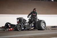 Nov 1, 2019; Las Vegas, NV, USA; NHRA top alcohol funny car driver Doug Gordon climbs from his car after crashing during qualifying for the Dodge Nationals at The Strip at Las Vegas Motor Speedway. Gordon would be uninjured in the crash. Mandatory Credit: Mark J. Rebilas-USA TODAY Sports