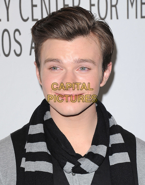 CHRIS COLFER.at The PaleyFest 2011 Panel for Glee held at The Saban Theater in Beverly Hills, California, USA, March 16th,2011..portrait headshot grey gray black scarf                                                                                .CAP/RKE/DVS.©DVS/RockinExposures/Capital Pictures.