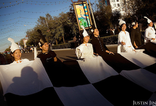 Youngsters dressed in chess pieces parade in Elista, capital of the southern Russian republic Kalmykia. ..The republic is run by Kirsan Ilyumzhinov, 44, a chess fanatic. Ilyumzhinov, who also presides over the World Chess Federation, Fide, is hosting one of the world?s most important matches in history. ..The match beginning September 21 in Elista, the capital of Europe?s only Buddhist nation, will end a 13-year split in the game that has produced rival claims to the title. ..Veselin Topalov, a Bulgarian ranked first according to Fide, will play against Vladimir Kramnik, who is the Classical Chess World Champion, a title established after Garry Kasparov led a breakaway from Fide in 1993. The two grandmasters, both aged 31, will face each other for the right to be undisputed world chess champion...A Buddhist millionaire businessman, Ilyumzhinov acquired his wealth in the economic free-for-all which followed the collapse of the Soviet Union. ..At the age of just over 30, he was elected president in 1993 after promising voters $100 each and a mobile phone for every shepherd. Soon after, he introduced presidential rule, concentrating power in his own hands. ..He denies persistent accusations of corruption, human rights abuses and the suppression of media freedom. When Larisa Yudina, editor of the republic's only opposition newspaper and one of his harshest critics, was murdered in 1998, he strenuously rejected allegations of involvement. ..Mr Ilyumzhinov has been president of the International Chess Federation (FIDE) since 1995 and has been enthusiastic about attracting international tournaments to Kalmykia. His extravagant Chess City has led to protests by its impoverished citizens. ....