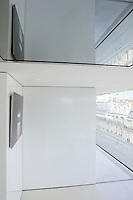 Sliding partitions are used thoughout the apartment to transform the living spaces