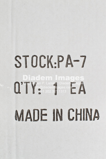 "The side of packing box showing the item as ""Made in China."""