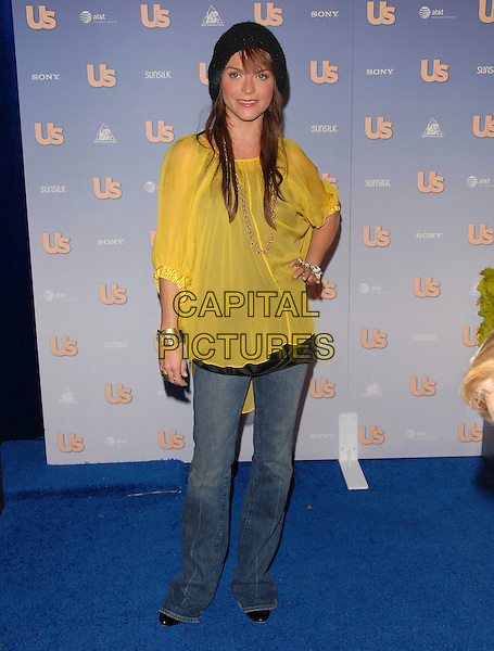 TARYN MANNING.The US Weekly Hot Hollywood 2007 Celebration held at Opera in Hollywood, California, USA. .September 25th, 2007 .full length yellow sheer top sheer hand on hip jeans denim  black hat knitted .CAP/DVS.©Debbie VanStory/Capital Pictures