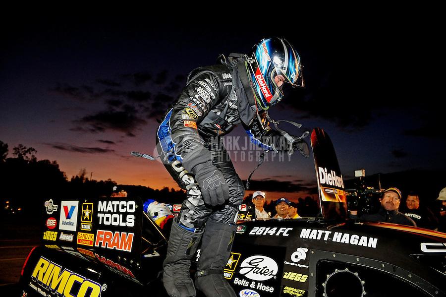 Nov. 13, 2011; Pomona, CA, USA; NHRA funny car driver Matt Hagan celebrates after winning the Auto Club Finals at Auto Club Raceway at Pomona. Mandatory Credit: Mark J. Rebilas-.