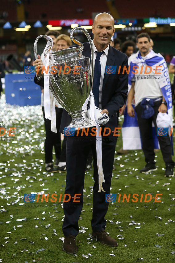 df2bcf9719d9d Real Madrid Manager Zinedine Zidane celebrates with the trophy after the  UEFA Champions League Final match