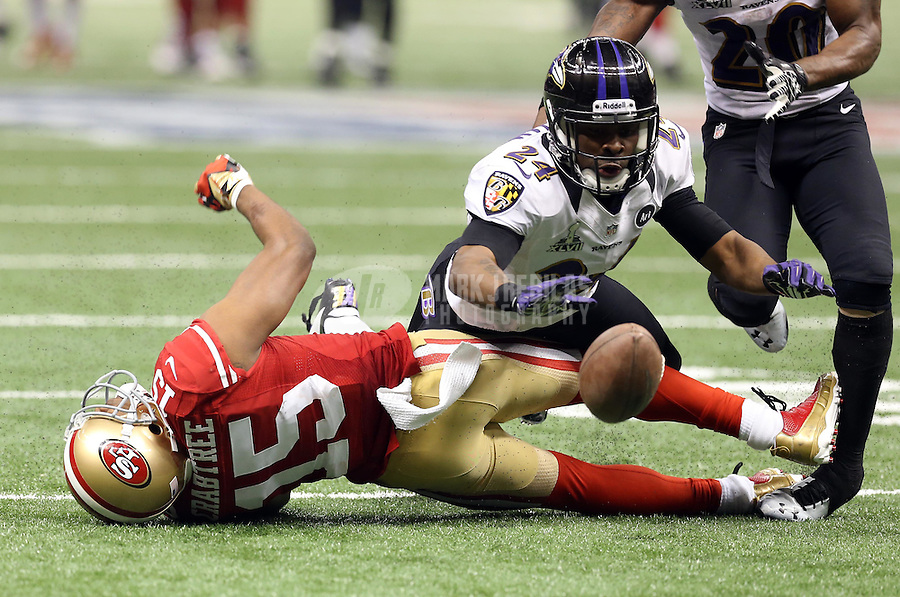 Feb 3, 2013; New Orleans, LA, USA; Baltimore Ravens cornerback Corey Graham (24) breaks up a pass intended for San Francisco 49ers wide receiver Michael Crabtree (15) in Super Bowl XLVII at the Mercedes-Benz Superdome. Mandatory Credit: Mark J. Rebilas-