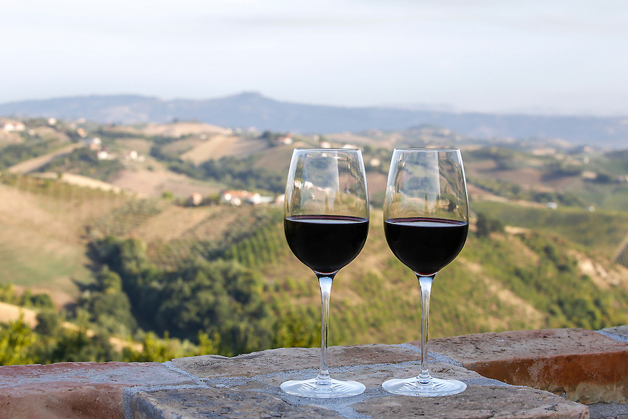 Cheers with red wine from the region of the Marche.