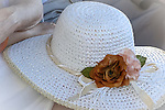Photo of a sun hat on a woman's lap in a park in Sorrento Italy.