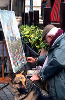 An artist painting in the Grand Place square, Brussels, Belgium, Europe
