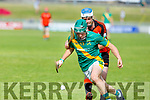 Ballyheigues Padraig Behan keeps a tight rein on  Kilmoyleys Maurice O'Connor in R2 of the Senior Hurling championship on Saturday night.