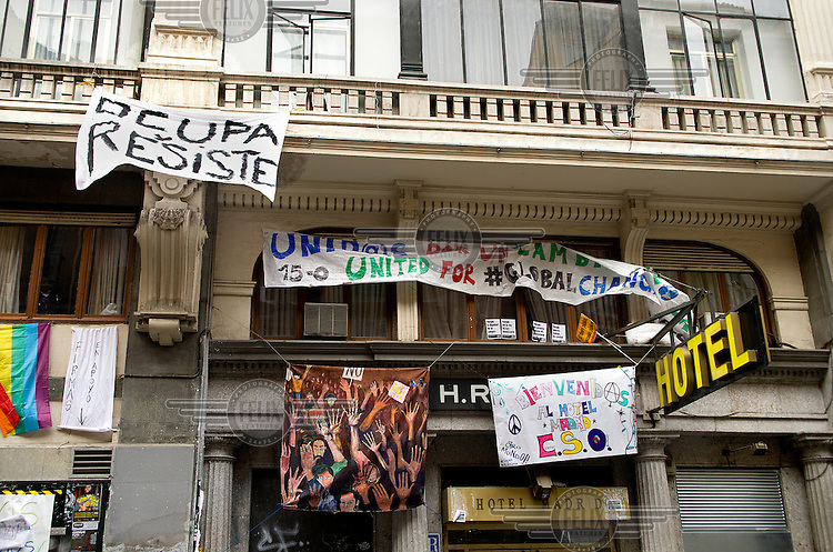 Political posters hang up at Hotel Madrid before the 15 October global protests.