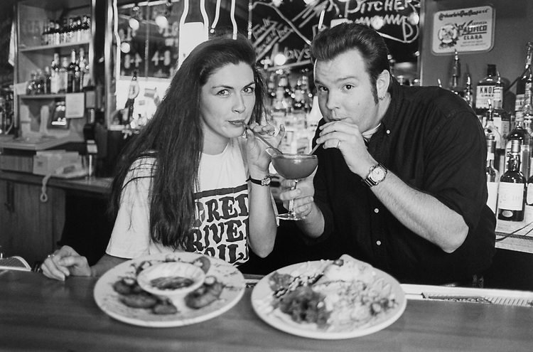 Kerryn O Neil (bartender) and owner Mattew Weiss share Strawberry Margarita with Texas Hot Rock and Jerk Chicken Burrito on June 26, 1995. (Photo by Laura Patterson/CQ Roll Call via Getty Images)