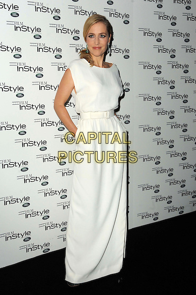 Gillian Anderson.The InStyle magazine 10th anniversary party, Sanctum Soho hotel, Warwick St., London, England..November 22nd, 2011.full length white sleeveless dress maxi hand in pocket belt .CAP/CAS.©Bob Cass/Capital Pictures.