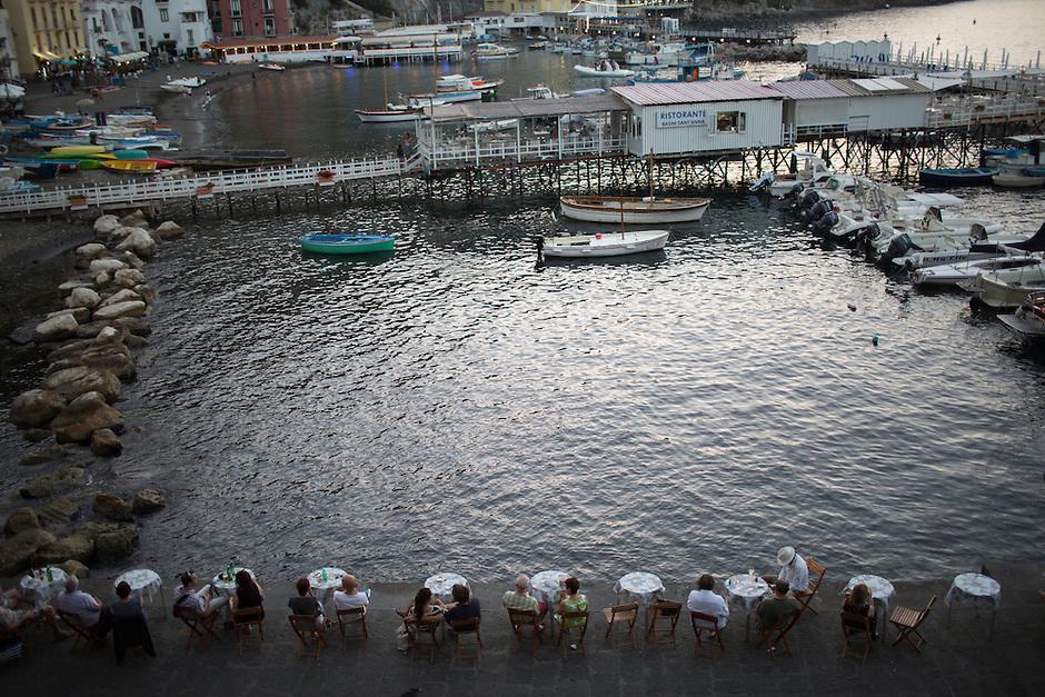 People enjoy drinks along the Marina Grande on Thursday, Sept. 17, 2015, in Sorrento, Italy. (Photo by James Brosher)