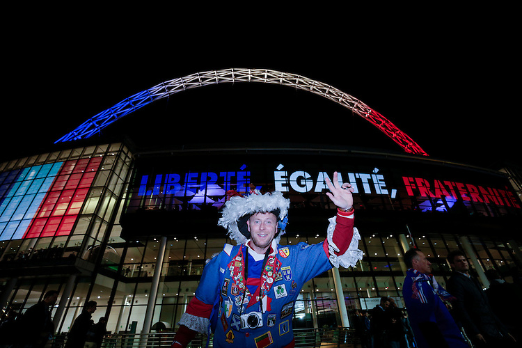 A French fan poses for a photo outside Wembley Stadium, home of England football<br /> <br /> Photographer Craig Mercer/CameraSport<br /> <br /> Football International - England v France - Tuesday 17th November 2015 - Wembley Stadium - London<br /> <br /> &copy; CameraSport - 43 Linden Ave. Countesthorpe. Leicester. England. LE8 5PG - Tel: +44 (0) 116 277 4147 - admin@camerasport.com - www.camerasport.com