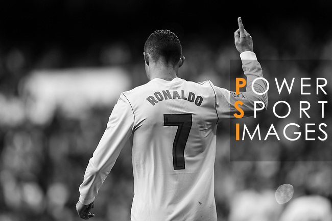 Cristiano Ronaldo of Real Madrid celebrating his score during the La Liga 2017-18 match between Real Madrid and Sevilla FC at Santiago Bernabeu Stadium on 09 December 2017 in Madrid, Spain. Photo by Diego Souto / Power Sport Images<br /> <br /> (EDITORS NOTE, THIS IMAGE HAS BEEN CHANGED COLOURS FOR BLACK AND WHITE BY LR)