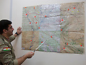 Iraq 2014 <br />     Sirwan Barzani, Peshmerga officer in charge of the 6th branch in Mahmur district, showing on the map the front line <br /> Irak 2014 <br /> Sirwan Barzani, officier de peshmergas, responsable de la 6eme branche region de Mahmur, montrant sur la carte la ligne de front
