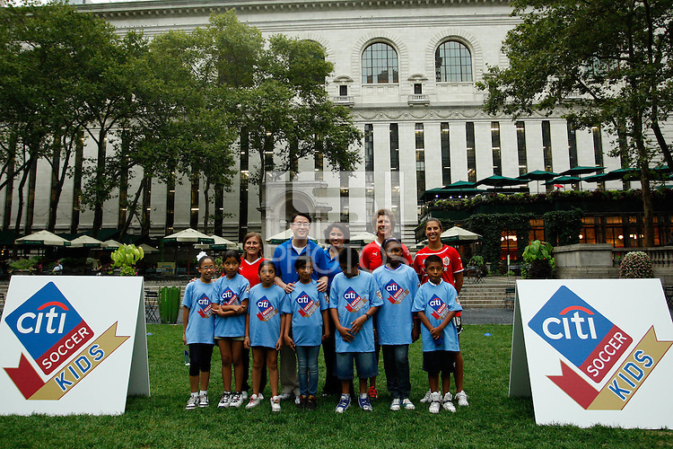 Group photo with Tiffeny Milbrett, Michelle Akers, and Carli LLoyd during a Women's Professional Soccer (WPS) clinic staffed by coaches from UK international Soccer Camps at Bryant Park in New York, NY, on August 25, 2011.