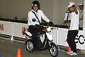 """July 14, 2010 - Tokyo, Japan - A reporter test drives the Yamaha Motor's new electric commuter vehicle EC-03 in Tokyo, Japan, on July 14, 2010. Yamaha Motor will begin selling from September 1 in the Tokyo area and nationwide from October 1, then will introduce the EC-03 in the markets of Taiwan and Europe in 2011. The 240,000 yen ($2,700) """"smart minimal commuter"""" achieves a running distance per charge of 43 km, powered by 50V lithium-ion battery manufactured by Sanyo."""