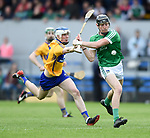 Diarmuid Ryan of Clare in action against Conor Boylan of Limerick during their Munster U-21 hurling quarter final at Cusack park. Photograph by John Kelly.